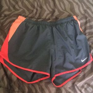 Nike grey and orange lined running shorts